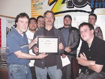 Dennis Michaels picks up award from College of the Siskiyous radio crew..
